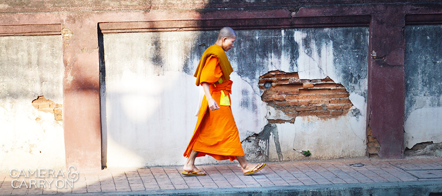 Monk walking in Chiang Mai, Thailand  -- 24 Photos That Will Inspire You to Travel the World NOW | CameraAndCarryOn.com