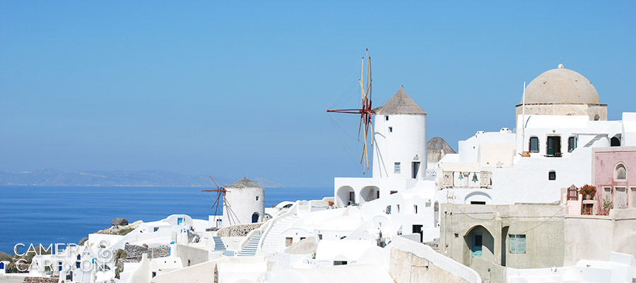 Windmill in Oia, Santorini, Greece -- 24 Photos That Will Inspire You to Travel the World NOW | CameraAndCarryOn.com